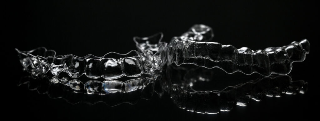 A pair of touch clear aligners